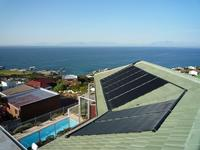 AM Engineering Solar Pool Heating System - 7 Panels on Sloped Roof
