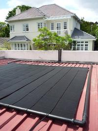 Heliocol Solar Pool Heatng System - 3 Panels on Flat Roof