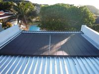 Heliocol Solar Pool Heating System - 4 Panels on Flat Roof